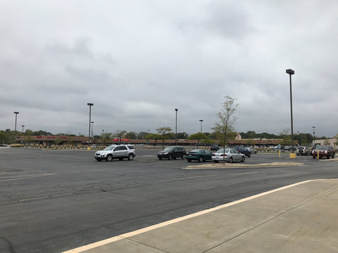 An empty parking lot at the Landings strip mall in the suburb of Chicago