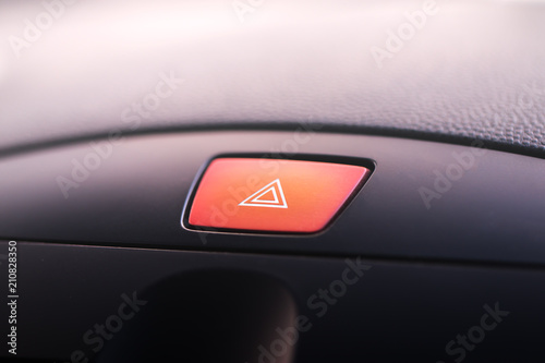 Car emergency warning light button in front car console