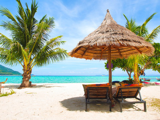 Poster Zanzibar Wooden beach chairs and straw parasol on white sand beach with turquoise water sea and clear blue sky in sunny summer day at Koh Lipe island in Thailand for vacation holiday concept.