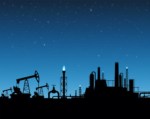 Extraction of gas and oil. Industrial plant on sunset background.