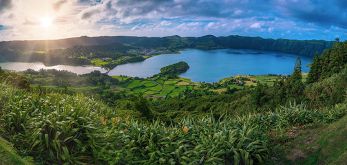 Beautiful sunset volcanic lake among mountains with green lush and trees in Ciete Cidades valley