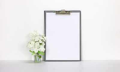 Clipboard mockup with white flowers