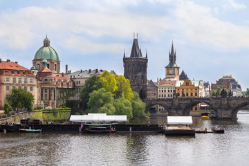 View to the Charles Bridge and St. Nikolaus Church in Prague