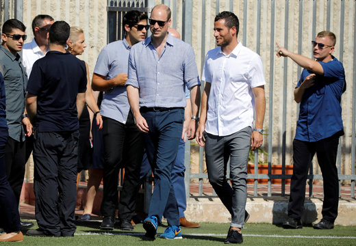 Britain's Prince William walks next to Tomer Hemed, an Israeli professional footballer, as he arrives ahead of a soccer event with Jewish, Muslim and Christian children organized by The Equalizer and Peres Center for Peace in Jaffa