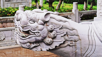 Closeup Shot of A Beautiful Traditional Chinese Stone Mythical Animal Statue as A Guardian / Protection or Lucky Symbol in A Buddhism Temple of China.