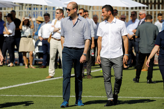 Britain's Prince William walks with Tomer Hemed during a soccer event organized by The Equalizer and Peres Center for Peace in Jaffa