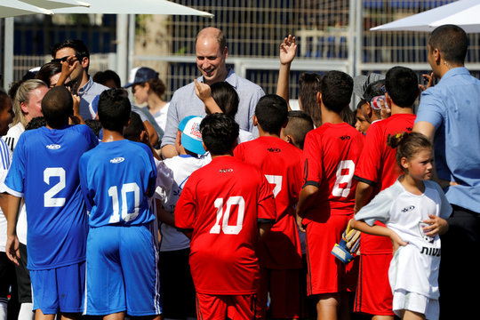 Britain's Prince William speaks with Jewish, Muslim and Christian children during a soccer event organized by The Equalizer and Peres Center for Peace in Jaffa