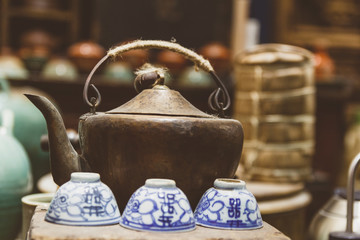 Kettle and tea cups in antique tea house