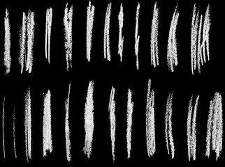 Set of chalk brushes lines hand drawn illustration, isolated on black.