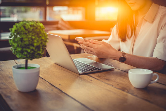 Close up of businesswoman working at outdoors office with laptop and mobile. People and Lifestyles concept. Business and Financial theme. Freelance at coffee shop theme.