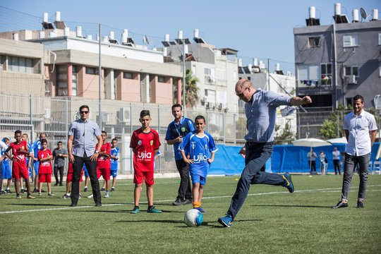 Britain's Prince William participates in a soccer game with Jewish, Muslim and Christian children organized by The Equalizer and Peres Center for Peace in Jaffa