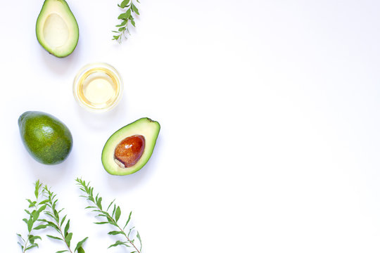 Avocado on the white background frame. Copy space. Top view
