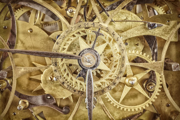 Innerworks of an antique clock with gear wheels