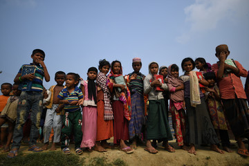 Rohingya refugee children leave school after a morning of classes in Shamplapur refugee camp in Cox's Bazaar