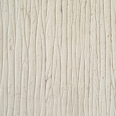 Decorative plaster on the wall, abstract background, imitation of stripes