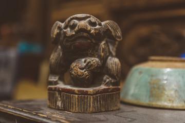 Wooden dog figurine in antique shop