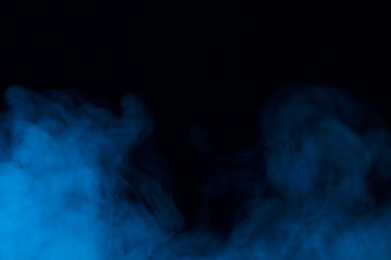 clouds of blue dense couple on a dark background