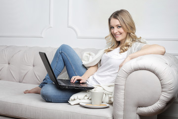 Girl on the sofa using a laptop