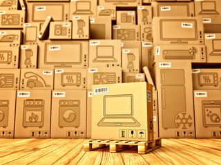 Shopping, purchase and delivery concept, box with a laptop icon on the background of a cardboard boxes with household appliances and electronics in the warehouse