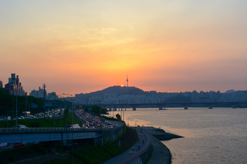 Rush hours river side Seoul at sunset