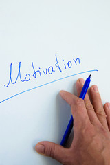 """Woman hand writing the word """"Motivation"""" on white background"""