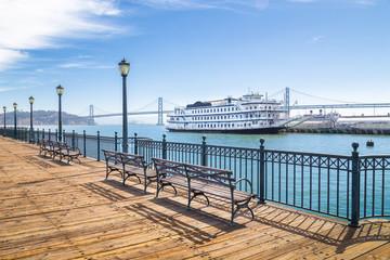 Historic Pier 7 with paddleboat and Bay Bridge, San Francisco, USA