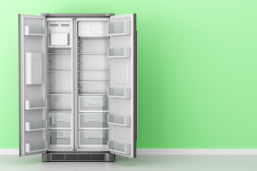 open empty fridge in front of green wall
