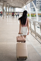 Chinese woman pull luggage to travel