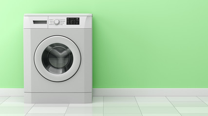 modern washing machine in front of green wall