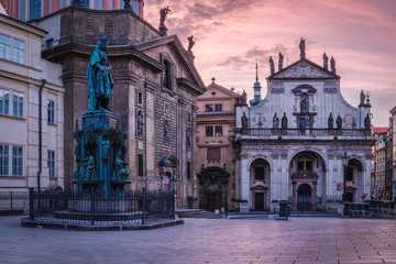 Krizovnicke square at the morning. Golden hour in Prague with city gas lamps and Charles IV statue, Czech Republic