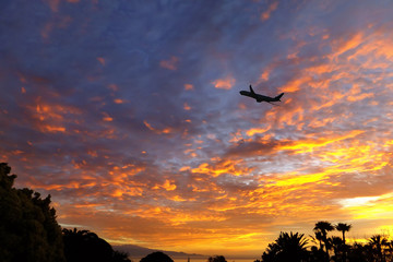 silhouette of airplane on the sunset sky. Canary Islands at sunset. La Gomera