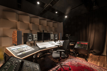 Empty control room with music equipment