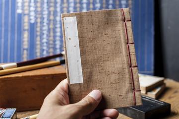 Japanese stab binding in hand