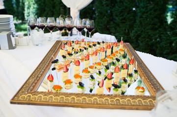 Foto op Canvas Buffet, Bar Delicious snacks on wedding reception table in luxury outdoor restaurant