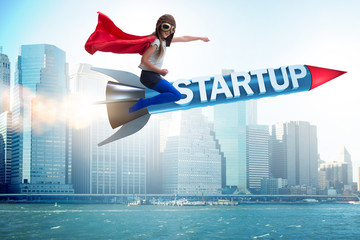 Small kid in start-up concept flying rocket