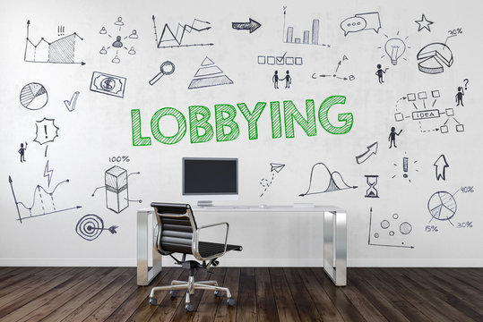 LOBBYING | Desk in an office with symbols