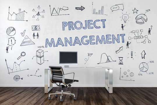 PROJECT MANAGEMENT Desk in an office with symbols