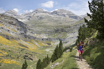 Young woman hiking in Ordesa y Monte Perdido National Park in Pyrenees, Huesca, Aragon, Spain