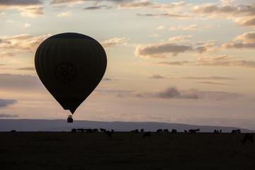 Hot air balloon flying at sunset