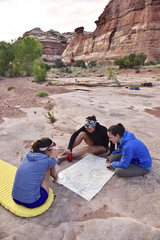Female hikers looking at map in Canyonlands National Park, Moab, Utah, USA