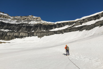Mountain climber on glacier in Rocky Mountains of Banff National Park, Alberta, Canada