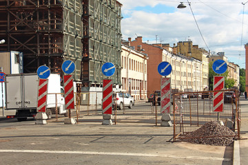fencing and signs of detour of road works on the roadway