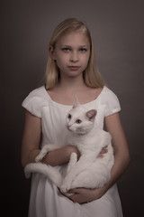Serious girl holding cat