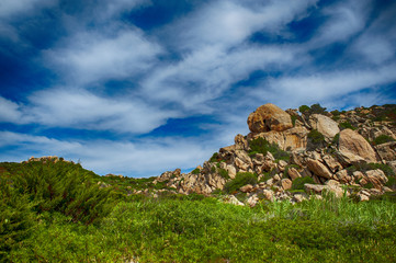 An amazing wild landscape of the hinterland of Sardinia where the green is mixed with pink granite that touches the sky