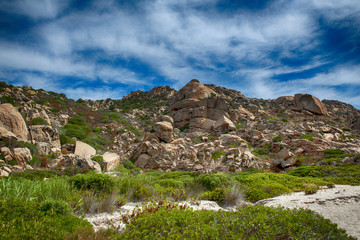 A stunning wild landscape of the hinterland of Sardinia where the green blends with pink granite that touches the sky