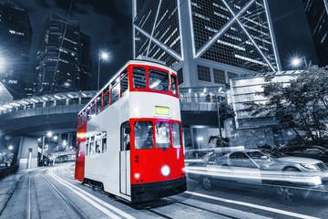Retro tram on the evening city street.
