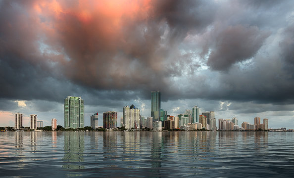 Dawn view of Miami Skyline reflected in water