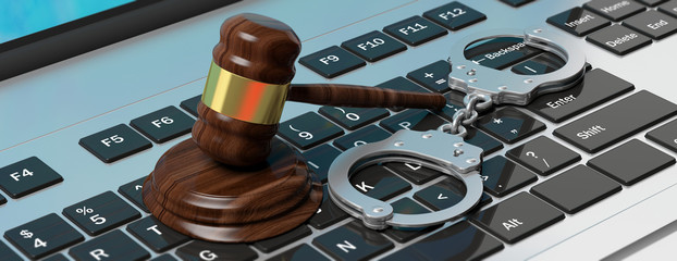 Metal handcuffs and judge gavel on computer keyboard, 3d illustration