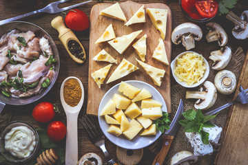 different cheeses and ingredients for cooking