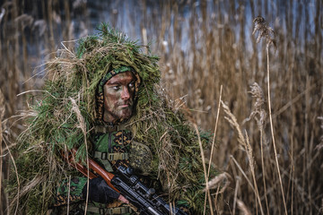 Portrait of an airsoft player